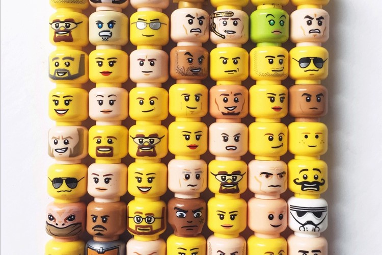 Layers Of Stacked Lego Toy Block Heads With Assorted Emotions On A White Background T20 6W90k6